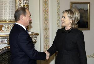 Then-Secretary of State Hillary Clinton shakes hands with Vladimir Putin back in 2010. (Getty Images)